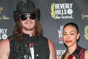 James Preston Rogers and Elsita Rogers are seen attending the 18th Annual International Beverly Hills Film Festival Opening Night Gala Premiere of 'Benjamin' at TCL Chinese 6 Theatres in Los Angeles, California.