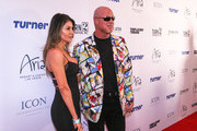 Jim McMahon and Mayra Montoya are seen attending the 2018 Derek Jeter Celebrity Invitational Gala at the Aria Resort & Casino in Las Vegas, Nevada.