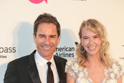Eric McCormack and Janet Holden are seen arriving to the 26th Annual Elton John AIDS Foundation's Academy Awards Viewing Party held at West Hollywood Park in Los Angeles, California.