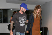 Adam Levine and Behati Prinsloo are seen.