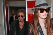 Al Pacino and Lucila Sola arrive at LAX.