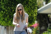 Amanda Seyfried walks her dog