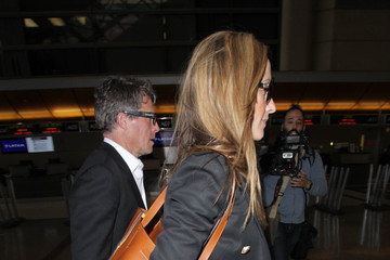 Anna Elisabet Eberstein Hugh Grant and Anna Elisabet Eberstein Are Seen at LAX