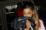 Ariana Grande Touches Down at LAX