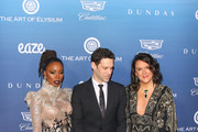 Shanola Hampton, Jennifer Howell and Justin Bartha are seen attending at the Art of Elysium's 12th Annual Celebration Heaven at the Cosmetic Plaza in Los Angeles, California.