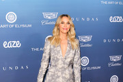 Arielle Kebbel is seen attending at the Art of Elysium's 12th Annual Celebration Heaven at the Cosmetic Plaza in Los Angeles, California.