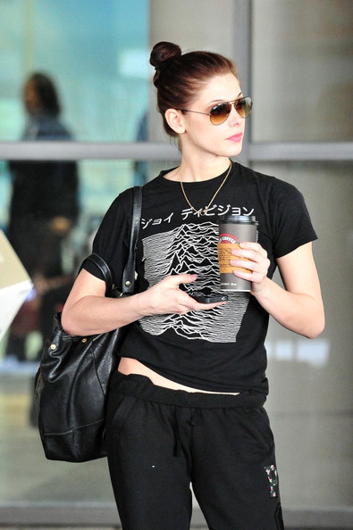 Ashley Greene Ashley Greene rubs her tummy as she drops some cash at starbucks upon arrival at LAX (Los Angeles International Airport).