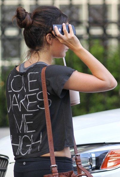 Ashley Tisdale Ashley Tisdale leaves the gym after a workout and tries to hide from the camera.