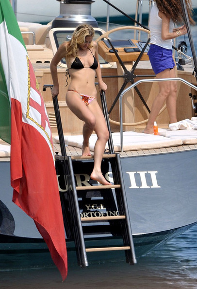 Newly single super-model, Bar Refaeli shows off her figure in a barely there