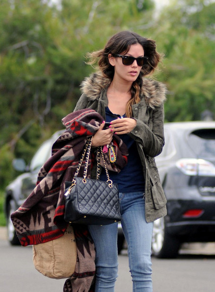 Rachel Bilson arrives to a film set wearing a coat and carrying a blanket to ensure she can stay warm.