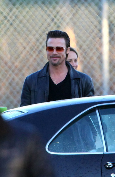 Brad Pitt looks slick and cool as he films scenes from his latest movie Cogan's Trade.