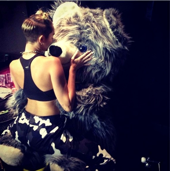 Miley Cyrus got freaky with a giant teddy bear.