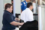 Chaz (formerly Chastity) Bono appears even more flat-chested as he checks into Los Angeles International Airport (LAX) to catch a departing flight. Chaz is still undergoing a female-to-male gender transition.