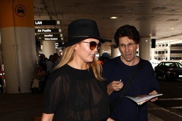 Chrissy Teigen Chrissy Teigen Wears Black at LAX