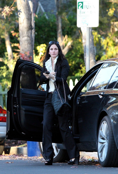 Courteney Cox and daughter Coco are seen visiting friends on Christmas Eve.