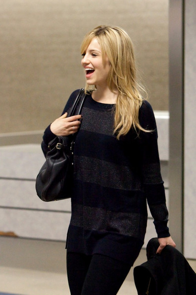 Dianna Agron Dianna Agron seems gleeful as she arrives at LAX (Los Angeles International Airport).
