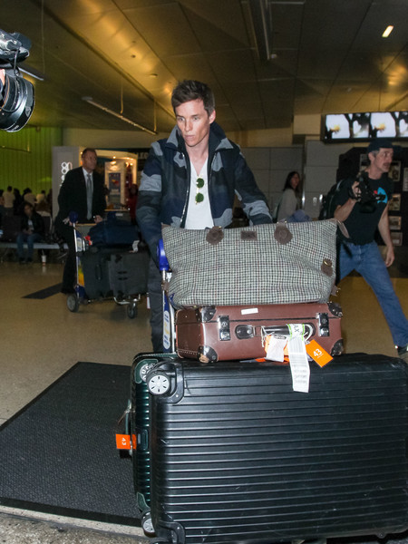 Eddie Redmayne Strolls Through LAX