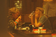21-year-old Ekaterina Ivanova finds comfort in a friend over a Chinese dinner 4 days after her lover Rolling Stone's guitarist Ronnie Wood's arrest on suspicion of domestic assault.  Heartbroken Ekaterina who allegedly  wants Ronnie back had a heartwarming soup and made sure she read her fortune cookie before going to Tesco to buy Maltesers chocolate for desert.