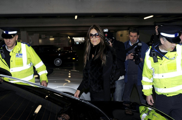 Elizabeth Hurley Elizabeth Hurley arrives at Heathrow Airport with a police escort.