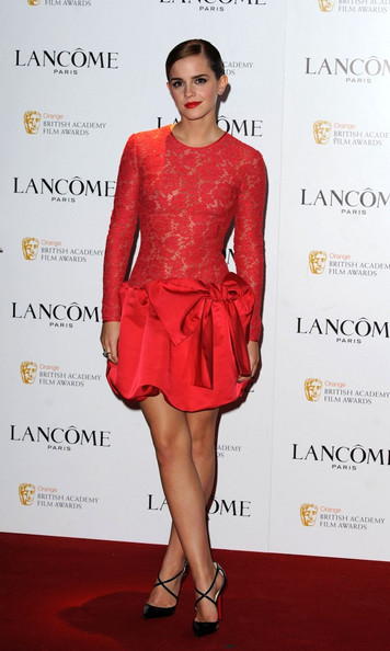 Emma Watson Emma Watson looks stunning in a red lace dress with matching lipstick on the red carpet for the Lancome pre-BAFTA Cocktail Party held at The Savoy.