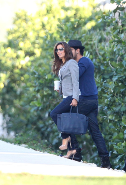 Eva Longoria Eva Longoria spends time with Eduardo Cruz, the brother of Penelope Cruz. They stayed on a friends luxury yacht before attending the Market America Convention at the AA Arena in Miami. Eduardo had his arm around Eva and kissed her gently on the head before sharing a glass of wine on the yacht.