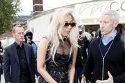 Lady Gaga wears a corset and eye-catching platform shoes while out in the South Bank for an interview with Anderson Cooper.