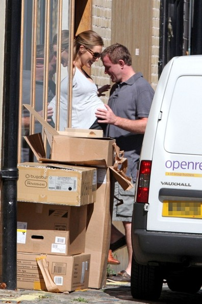 Guy Ritchie Guy Ritchie tenderly strokes his glowing pregnant girlfriend Jacqui Ainsley's massive baby bump before leaving the house.  Reportedly, the 42-year-old Sherlock Holmes director and his model girlfriend, 29, are expecting a baby boy in September.