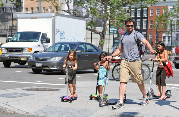 Super dad Hugh Jackman rides a scooter as he picks up his daughter, Ava Eliot (b.