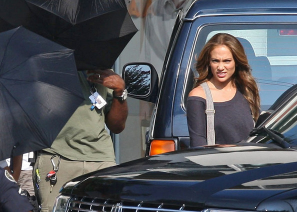 "Jennifer Lopez makes some strained faces as she films scenes for ""What to Expect When You're Expecting"" in the Southern heat."