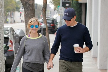 Jim Toth Reese Witherspoon and Jim Toth Hold Hands