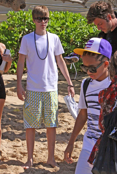 Justin Bieber 16 year old Canadian singing sensation Justin Bieber plays 2 sold-out concerts in Honolulu.Just before the first concert he does an interview with Maira Menounos (grey striped top) for the TV show Access Hollywood.The next day he goes for a boat ride on a catamaran called 'Mai Tai' with Jayden Smith and Jasmin Villegas .