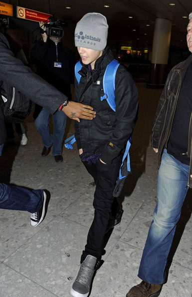 Justin Bieber Justin Bieber keeps his head down as he arrives at Heathrow airport to attend the Brit Awards.