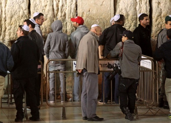 Justin Bieber ***NO WEB/BLOG WITHOUT PRIOR APPROVAL FROM RANDY BAUER - bauergriffinsales@gmail.com ***.Justin Bieber visits the Wailing Wall with his very heavy security detail surrounding him. At one point the popular site is shut down for other visitors as Bieber's visit continues to stir much attention and controversy.