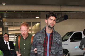 Justin Mikita Jesse Tyler Ferguson and Jason Mikita Are Seen at LAX