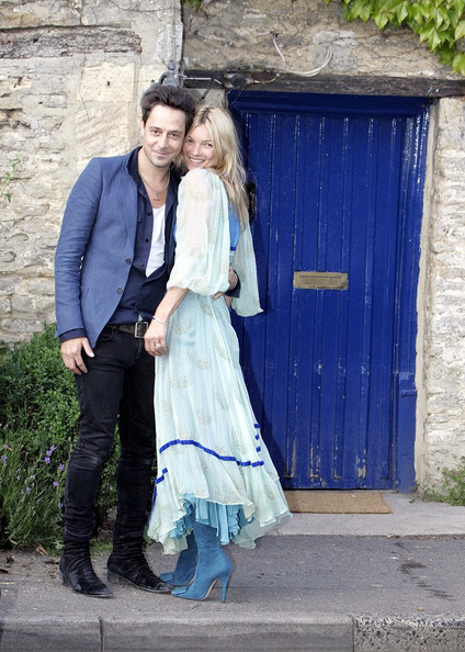 Kate Moss and Jamie Hince are all smiles the eve of their wedding.