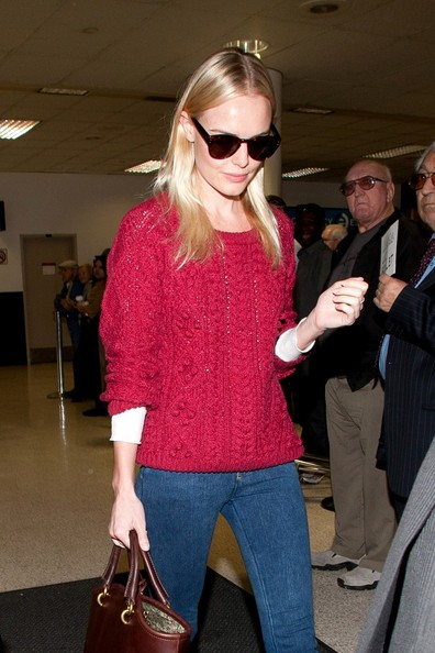 Kate Bosworth arrives at LAX (Los Angeles International Airport) wearing a bright red shirt.