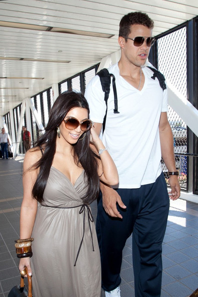 Kim Kardashian Kim Kardashian and husband Kris Humphries prepare to depart LAX (Los Angeles International Airport).