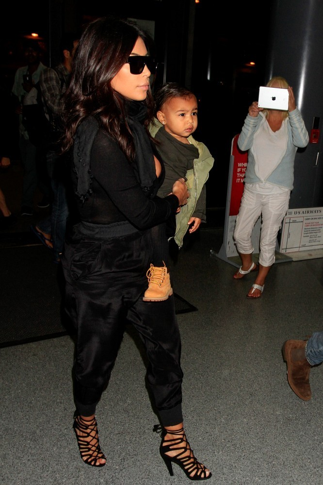 Kim Kardashian and Family Visit With Kids at Thai Orphanage—All the ...