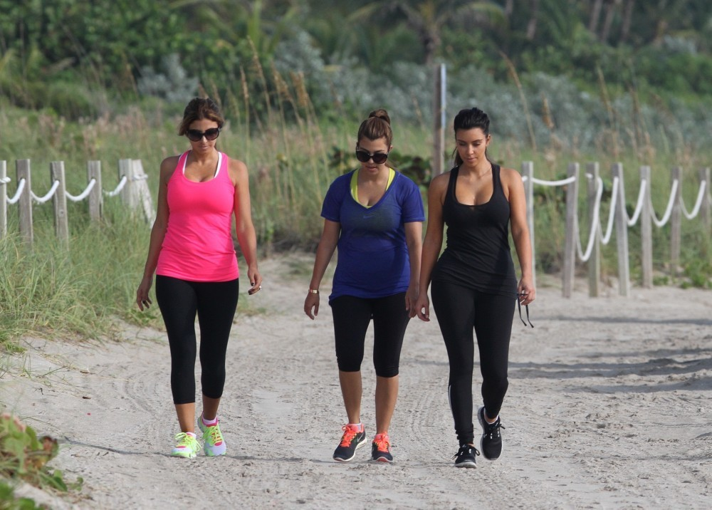 Kim and kourtney kardashian take a walk zimbio for What does kourtney kardashian do