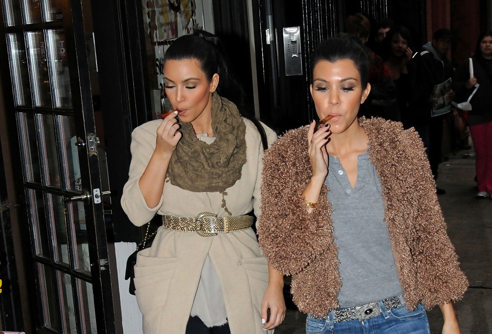 Kim Kardashian smoking a cigarette (or weed)