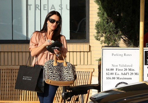 "Kyle Richards ""Real Housewives of Beverly Hills"" reality star Kyle Richards waits for her car at the valet after shopping at Barney's New York."