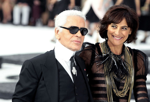 Karl Lagerfeld walks the runway wih Ines de la Fressange at the Grand Palais following the Chanel Ready-to-Wear Spring/Summer 2011 show during Paris Fashion Week.
