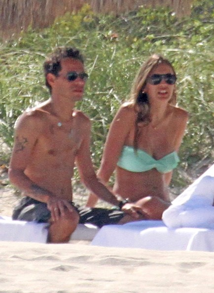 The Virgo with shirtless slim body on the beach