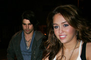 Miley Cyrus and Justin Gaston Photos Photo