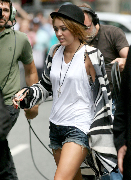 Miley Cyrus Miley Cyrus wears very short denim shorts and signs autographs before her appearance on