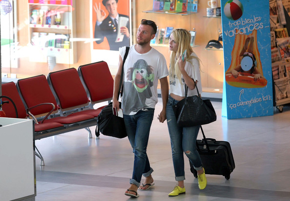 Mischa Barton doesn't mince her words as she prepares to depart from Nice airport with her boyfriend Alexander wearing a statement t-shirt.