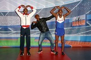 Mo Farah Poses with His Wax Figures