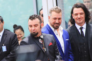 Chris Kirkpatrick, Joey Fatone and JC Chasez are seen at the ceremony honoring NSYNC with a star on the Hollywood Walk of Fame in Los Angeles, California.