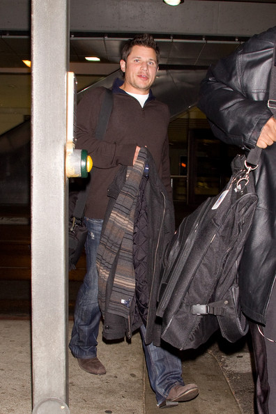 Nick Lachey is all smiles as he arrives at Los Angeles International Airport (LAX).