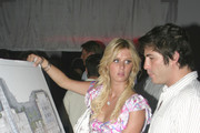Nicky Hilton shows pals Brandon Davis and Scott Storch the plans for her first high-end boutique hotel 'Nicky O South Beach'.
